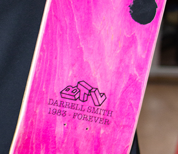A closeup of the skateboard designed with Three Wishes.